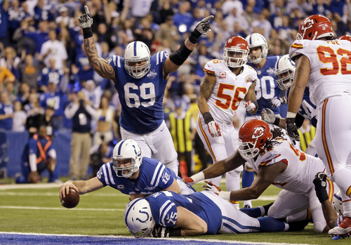 FILE - In this Saturday, Jan. 4, 2014, file photo, Indianapolis Colts quarterback Andrew Luck (12) dives in for a 5-yard fumble recovery for a touchdown during the second half of an NFL wild-card playoff football game Kansas City Chiefs in Indianapolis. Luck has already beaten Peyton Manning and pulled off the second greatest comeback in playoff history. What does he do for an encore? On Saturday, the second-year quarterback will try to upstage three-time Super Bowl winner Tom Brady, on Brady's home turf.  (AP Photo/Michael Conroy, File)