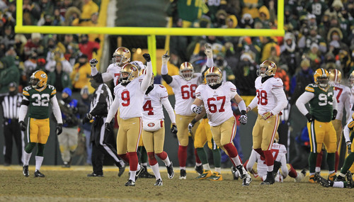San Francisco 49ers kicker Phil Dawson (9) pumps his fist after his game-winning field goal as the 49ers' 23-20 win over the Green Bay Packers at the conclusion of an NFL wild-card playoff football game, Sunday, Jan. 5, 2014, in Green Bay, Wis. (AP Photo/Milwaukee Journal Sentinel, Rick Wood)