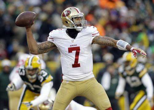 San Francisco 49ers quarterback Colin Kaepernick (7) throws a pass during the first half of an NFL wild-card playoff football game against the Green Bay Packers, Sunday, Jan. 5, 2014, in Green Bay, Wis. (AP Photo/Jeffrey Phelps)
