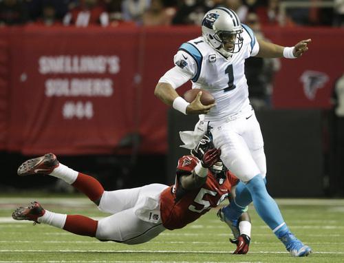 Atlanta Falcons outside linebacker Joplo Bartu (59) tries to tackle Carolina Panthers quarterback Cam Newton (1) during the second half of an NFL football game, Sunday, Dec. 29, 2013, in Atlanta. (AP Photo/John Bazemore)