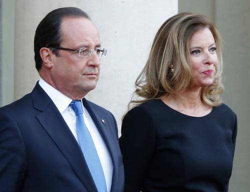 FILE - In this Sept. 3, 2013 file photo, French president Francois Hollande and his companion Valerie Trierweiler wait for German President Joachim Gauckand, at the  Elysee Palace, in Paris. The magazine Closer published images Friday Jan. 10, 2014 showing his bodyguard and a helmeted man it says is Hollande visiting what it says is the apartment of the actress. Hollande is threatening legal action over magazine report saying he is having a secret affair with a French actress. (AP Photo/Jacques Brinon, File)