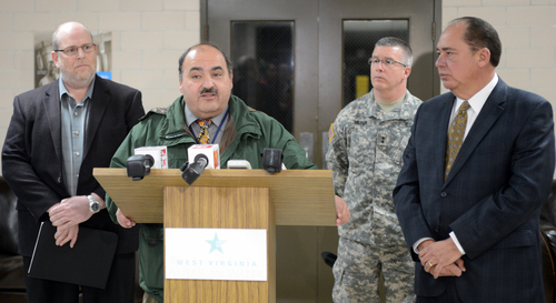 Jimmy Gianato, the director of the West Virginia Department of Homeland Security, at podium, addresses reporters during a press conference about the regional water contamination late Thursday, Jan. 9, 2014.  in Charleston, W.Va.  With him are West Virginia American Water President Jeff McIntyre,left,  West Virginia National Guard Adj. Gen. James Hoyer and Governor Earl Ray Tomblin, right.  (AP Photo,Tom Hindman)