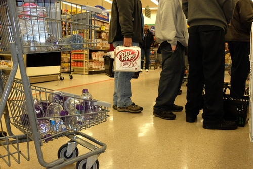 Residents of South Charleston, W.Va., wait in line at Kroger to buy water following a chemical spill on the Elk River that compromised the public water supply of eight counties on Thursday, Jan. 9, 2014. (AP Photo/Tyler Evert)