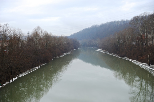 This Friday, Jan. 10, 2014 photo shows a stretch of the Elk River in Charleston, W.Va. The White House has issued a federal disaster declaration in West Virginia, where a chemical spill that may have contaminated tap water has led officials to tell at least 300,000 people not to bathe, brush their teeth or wash their clothes. The West Virginia National Guard planned to distribute bottled drinking water to emergency services agencies in the nine affected counties. About 100,000 water customers, or 300,000 people total, were affected, state officials said. (AP Photo/Tyler Evert)