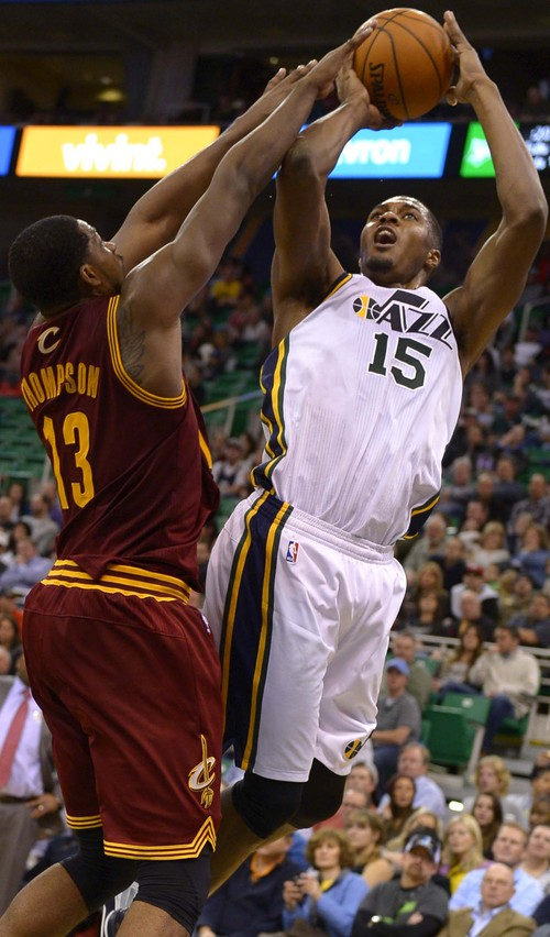 Leah Hogsten  |  The Salt Lake Tribune Utah Jazz power forward Derrick Favors (15) hits the net over Cleveland Cavaliers power forward Tristan Thompson (13). The Utah Jazz are defeated by the Cleveland Cavaliers 113-102, Friday, January 10, 2014 at Energy Solutions Arena.