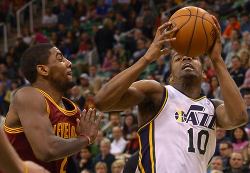 Leah Hogsten  |  The Salt Lake Tribune Utah Jazz point guard Alec Burks (10) drives to the net around Cleveland Cavaliers point guard Kyrie Irving (2). The Utah Jazz are defeated by the Cleveland Cavaliers 113-102, Friday, January 10, 2014 at Energy Solutions Arena.