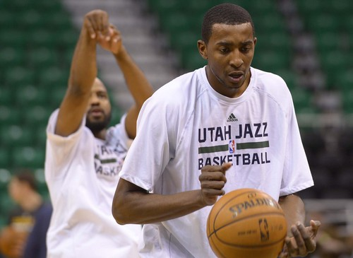 Leah Hogsten  |  The Salt Lake Tribune Utah Jazz forward Jeremy Evans (40) and Utah Jazz point guard John Lucas III (5) warm up on the court prior to their matchup against the Cleveland Cavaliers, Friday, January 10, 2014 at Energy Solutions Arena. Gordon Hayward will not play due to a hip injury.