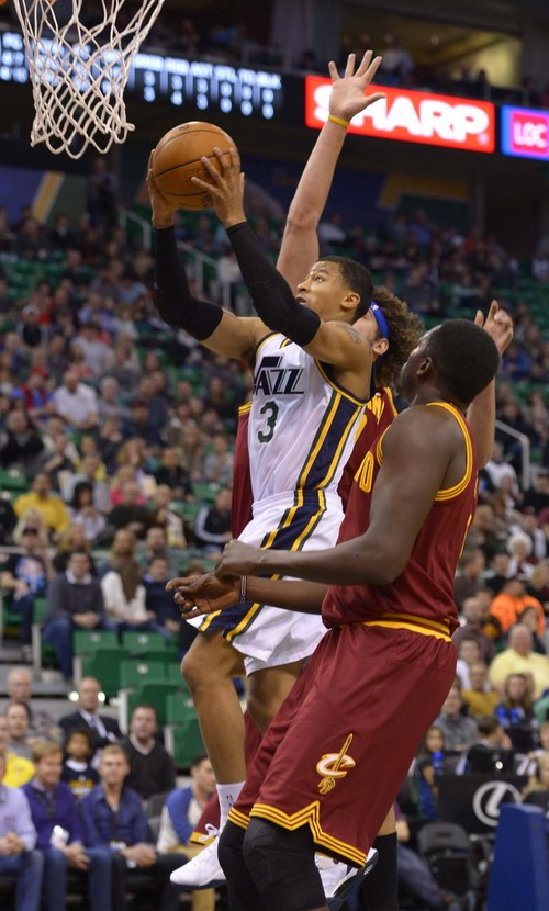 Leah Hogsten  |  The Salt Lake Tribune Utah Jazz point guard Trey Burke (3) is fouled by Cleveland Cavaliers center Anderson Varejao (17) during their matchup, Friday, January 10, 2014 at Energy Solutions Arena.