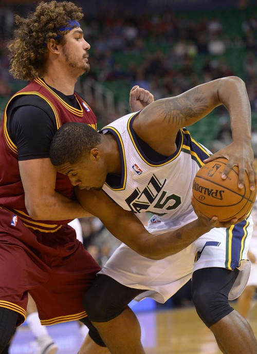 Leah Hogsten  |  The Salt Lake Tribune Utah Jazz power forward Derrick Favors (15) pressures Cleveland Cavaliers center Anderson Varejao (17) during their matchup, Friday, January 10, 2014 at Energy Solutions Arena.