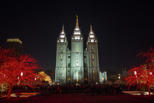 Chris Detrick  |  The Salt Lake Tribune Visitors look at the Christmas lights on Temple Square Friday November 29, 2013. The LDS Church released a statement Friday, Jan. 10 telling its lay clergy that they cannot perform gay marriages on church property or officiate weddings elsewhere.