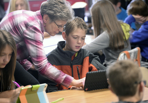 Al Hartmann     The Salt Lake Tribune Jill Jackson, a math teacher for 25 years, helps seventh grader Dylan Keyte  through a math problem on his iPad at Juab County Junior High in Nephi in December. The school has been phasing in a new interactive math curriculum.