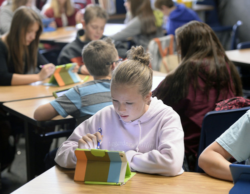 Al Hartmann     The Salt Lake Tribune Seventh graders at Juab County Junior High in Nephi work through math problems on their iPads in December. The school has been phasing in a new interactive math curriculum.