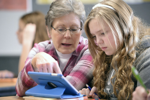 Al Hartmann     The Salt Lake Tribune Jill Jackson, a math teacher for 25 years, helps seventh grader Emily Newell  through a math problem on her iPad at Juab County Junior High in Nephi in December. The school has been phasing in a new interactive math curriculum.