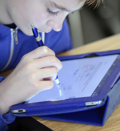 Al Hartmann     The Salt Lake Tribune Seventh grader Ben Settle is able to write his answer to a math problem on his iPad with a special pen at Juab County Junior High in Nephi in December. The school has been phasing in a new interactive math curriculum.