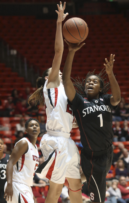 Stanford's Lili Thompson (1) shoots a layup as Utah's Danielle Rodriguez defends during the first half of an NCAA college basketball game Friday, Jan. 10, 2014, in Salt Lake City. (AP Photo/Kim Raff)