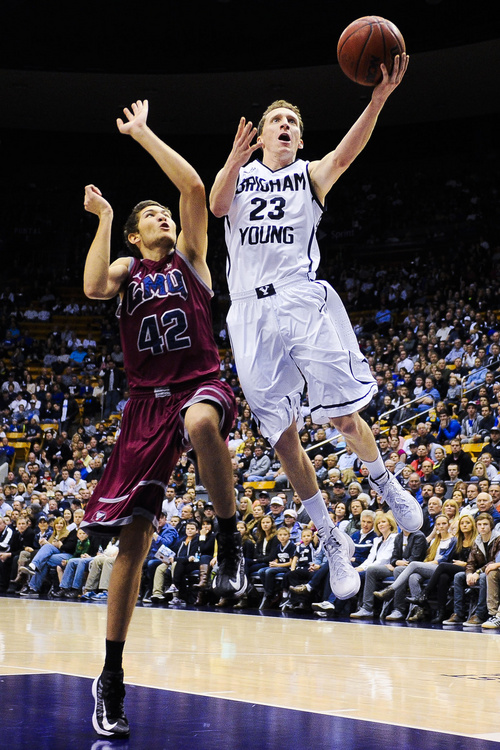 BYU guard Skyler Halford (23) attempts to shoot over Loyola Marymount's Marin Mornar during an NCAA college basketball game on Saturday, Jan. 11, 2014, in Provo, Utah. (AP Photo/Daily Herald, Alex Goodlett)