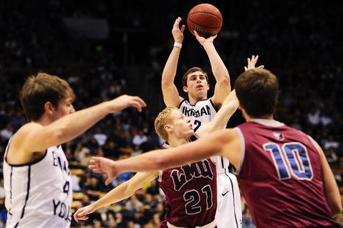 BYU guard Matt Carlino, top, shoots over Loyola Marymount's Max Heller (21) during an NCAA college basketball game on Saturday, Jan. 11, 2014, in Provo, Utah. (AP Photo/Daily Herald, Alex Goodlett)