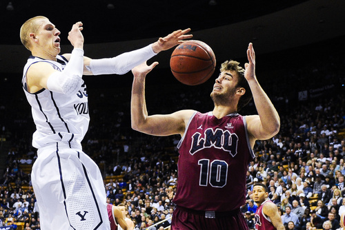 BYU forward Nate Austin, left, attempts to control the ball with Loyola Marymount's Ben Dickinson during an NCAA college basketball game on Saturday, Jan. 11, 2014, in Provo, Utah. (AP Photo/Daily Herald, Alex Goodlett)