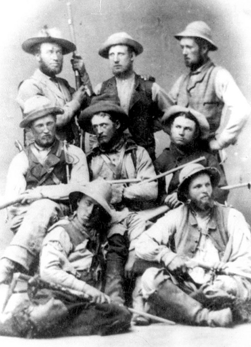 Photo Courtesy Utah State Historical Society  Blackhawk Soldiers in 1866. Back Row, left to right: Pratt, Alma; Wilkinson, Conrad; Dougall, William B., back, right. Middle Row: Goforth, William; Kimball, Solomon F.; Conrad, Jasper. Front Row: Snell, Henry; Woolley, Edward D., Jr.