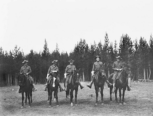 Photo Courtesy Utah State Historical Society  Image shows five mounted soldiers, patrolling through Yellowstone, 1911.