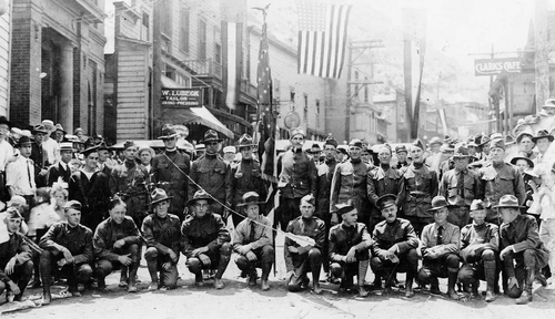 Photo Courtesy Utah State Historical Society  Bingham, Utah. A group of returned soldiers of World War I. Several ethnic groups are represented here. Charles Demas at the right of the sailor operated a grocery store in Bingham for half a century.