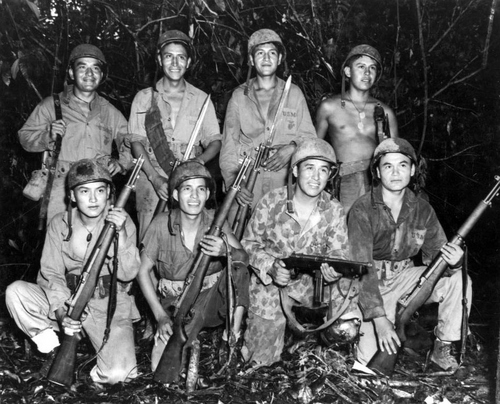 Photo Courtesy Utah State Historical Society  Group of Navajo Code Talkers in Bougainville, December 1943. Skilled in the native lore of their ancestors and a match for the Japanese in any fight are these Navajo Indians, serving with a Marine signal unit on Bougainville. Front row, left to right: Pvt. Earl Johnny, Pvt. Kee Etsicitty, Pvt. John V. Goodluck, and PFC David Jordon. Rear row, left to right: PVT Jack Tom H. Jones, and Captain Henry Bake, Jr.