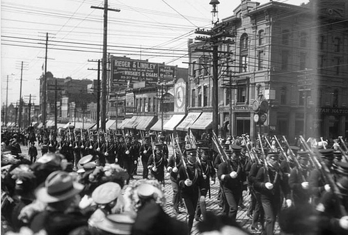 Photo Courtesy Utah State Historical Society  Image shows a group of Fort Douglas soldiers marching in a Decoration Day parade, 1907.