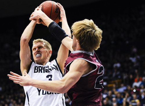 BYU guard Tyler Haws attempts to shoot the ball over Loyola Marymount's Chase Flint during an NCAA college basketball game Saturday, Jan. 11, 2014, in Provo, Utah. (AP Photo/Daily Herald, Alex Goodlett)