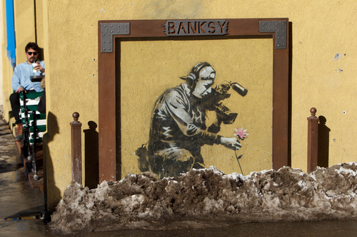 Trent Nelson  |  The Salt Lake Tribune Artwork by Banksy along Park City's Main Street on the opening day of the Sundance Film Festival Thursday January 17, 2013.