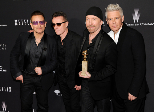 "Bono, from left, Larry Mullen, Jr., The Edge and Adam Clayton, of the Irish band U2, winners of the award for best original song for ""Ordinary Love"" from the film ""Mandela: Long Walk to Freedom,"" arrive at The Weinstein Company's Golden Globes after party at the Beverly Hilton Hotel on Sunday, Jan. 12, 2014, in Beverly Hills, Calif. (Photo by Chris Pizzello/Invision/AP)"