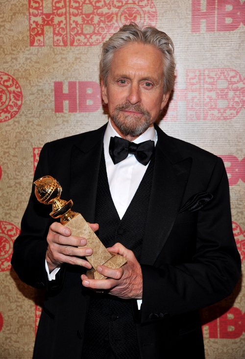 "Michael Douglas, winner of the award for best actor in a mini-series or motion picture made for television for ""Behind the Candelabra,"" arrives at the HBO Golden Globes after party at the Beverly Hilton Hotel on Sunday, Jan. 12, 2014, in Beverly Hills, Calif. (Photo by Richard Shotwell/Invision/AP)"