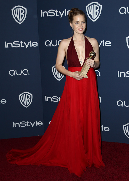 "Amy Adams arrives at the 15th annual InStyle and Warner Bros. Golden Globes after party at the Beverly Hilton Hotel on Sunday, Jan. 12, 2014, in Beverly Hills, Calif. Adams won the award for best actress in a motion picture, musical or comedy for her role in, ""American Hustle."" (Photo by Matt Sayles/Invision/AP)"