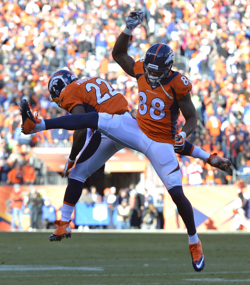 Denver Broncos wide receiver Demaryius Thomas (88) celebrates with Denver Broncos running back C.J. Anderson after scoring on a two-yard touchdown pass against the San Diego Chargers in the first quarter of an NFL AFC division playoff football game, Sunday, Jan. 12, 2014, in Denver. (AP Photo/Jack Dempsey)