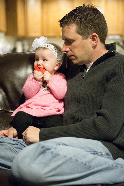 Jeremy Harmon  |  The Salt Lake Tribune  Ken Sullivan holds his 6-month-old daughter as he talks about the prospects of him going to Mars in 2025 while sitting with his family at their home in Farmington on Sunday, January 12, 2014.