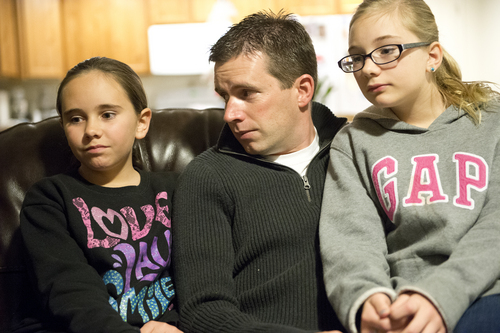 Jeremy Harmon  |  The Salt Lake Tribune  Ken Sullivan sits with his two oldest daughters, 12-year-old Kaitlyn, left, and 13-year-old Jocelyn, as he talks about the prospects of him going to Mars in 2025 during an interview at the family's home in Farmington on Sunday, January 12, 2014.