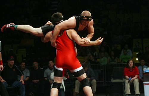 Kim Raff  |  The Salt Lake Tribune Brian Scott of Hurricane picks up Keanyn Zundel of Bear River in the 3A 220 lb match during the State Wrestling Tournament finals at Utah Valley University in Orem, Utah on February 18, 2012.
