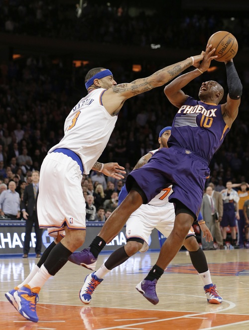 New York Knicks' Kenyon Martin (3) defends Phoenix Suns' Leandro Barbosa (10) during the second half of an NBA basketball game, Monday, Jan. 13, 2014, in New York.Martin was called for a foul on the play. The Knicks won the game 98-96. (AP Photo/Frank Franklin II)