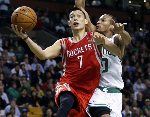 Houston Rockets point guard Jeremy Lin (7) drives to the hoop past Boston Celtics point guard Avery Bradley (0) in the second half of an NBA basketball game in Boston, Monday, Jan. 13, 2014. The Rockets won 104-92. (AP Photo/Elise Amendola)