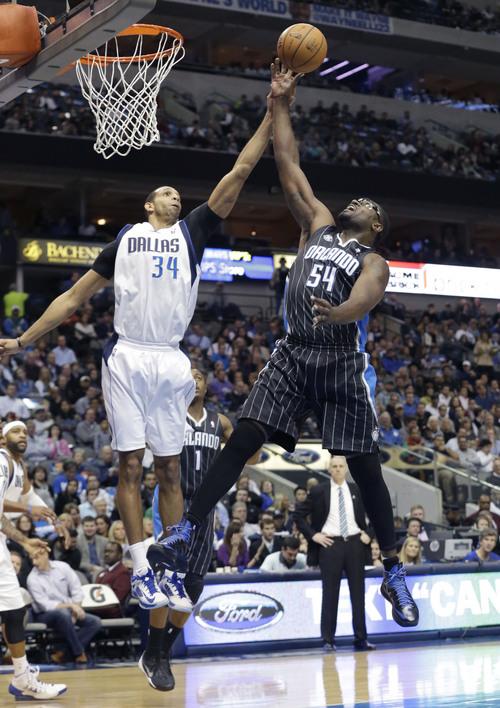 Orlando Magic power forward Jason Maxiell (54) and Dallas Mavericks power forward Brandan Wright (34) jump for the rebound during the first half of an NBA basketball game, Monday, Jan. 13, 2014, in Dallas. (AP Photo/LM Otero)