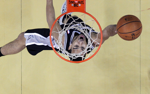 San Antonio Spurs point guard Cory Joseph (5) goes to the basket in the first half of an NBA basketball game against the New Orleans Pelicans in New Orleans, Monday, Jan. 13, 2014. (AP Photo/Gerald Herbert)