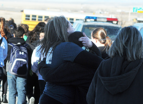 Students are escorted from Berrendo Middle School following a shooting, Tuesday, Jan. 14, 2014, in Roswell, N.M. Roswell police said the suspected shooter was arrested the school, but authorities have not said if there were any injuries. The school has been placed on lockdown. No other details are yet available. (AP Photo/Roswell Daily Record, Mark Wilson)