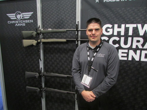 Tom Wharton | The Salt Lake Tribune Cade Penney of Christensen Arms of Gunnison shows off rifles his company was displaying at the annual SHOT Show in Las Vegas.