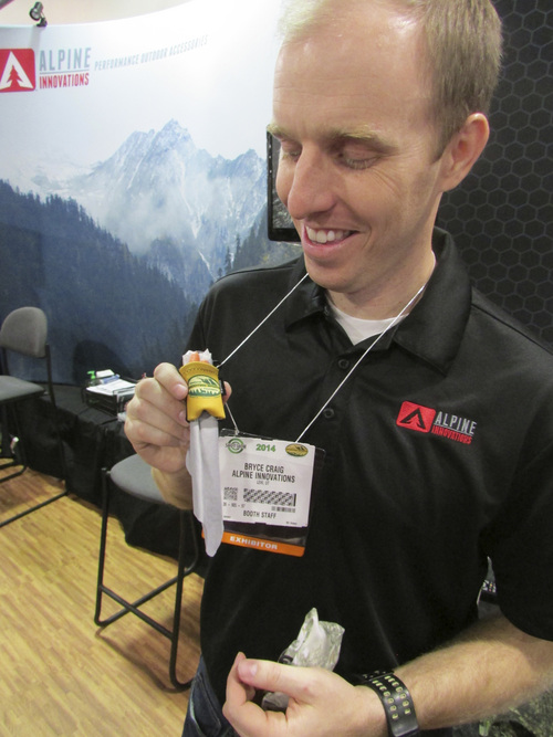 Tom Wharton | The Salt Lake Tribune Bryce Craig of Alpine Innovations of Lehi displays the Spudz Pro cleaning cloth used to clean gun scopes at the annual SHOT Show in Las Vegas.