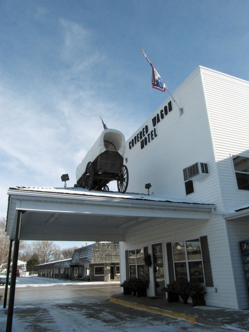 This Jan. 2, 2014 photo shows the Covered Wagon Motel in Lusk, Wyo., where electric car manufacturer Tesla installed four of its Supercharger units in the courtyard in December, 2013. A Supercharger can recharge a Tesla's depleted battery pack to a 90-percent level within 45-50 minutes, several times faster than any other charging option for the electric cars. Lusk is on the route of Tesla's first network of coast-to-coast Supercharger stations. The quick-charge stations promise to make cross-country travel by Tesla much quicker and easier. A new Supercharger station also was built in Blanding, the first in Utah. (AP Photo/Mead Gruver)