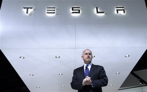 Diarmuid O'Connell, Tesla Vice President, Business Development speaks during media previews at the North American International Auto Show in Detroit, Tuesday, Jan. 14, 2014. (AP Photo/Paul Sancya)