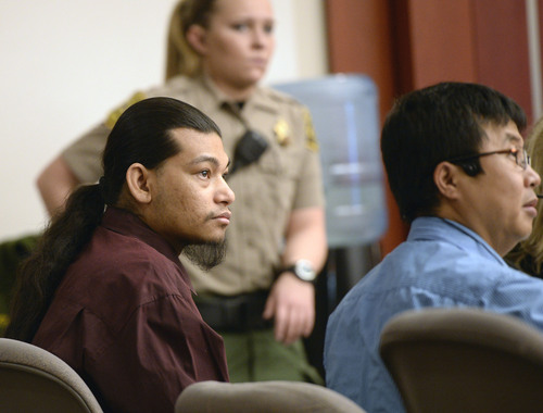 Al Hartmann  |  The Salt Lake Tribune Esar Met, left, sits with his interpreter in Judge Judith Atherton's courtroom in Salt Lake City Tuesday January 14, 2014 for his murder trial. Esar Met is accused of killing 7-year-old Hser Ner Moo, who disappeared on March 31, 2008.