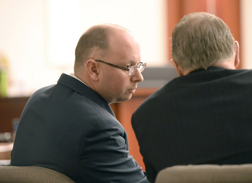 Al Hartmann  |  The Salt Lake Tribune Prosecuters Matt Janzen, left, and Robert Parrish confer during  Esar Met's murder trial in Salt Lake City Wednesday January 15, 2014.  The defense asked Judge Judith Atherton to declare a mistrial when new possible blood evidence was introduced. Esar Met is accused of killing 7-year-old Hser Ner Moo, who disappeared on March 31, 2008.