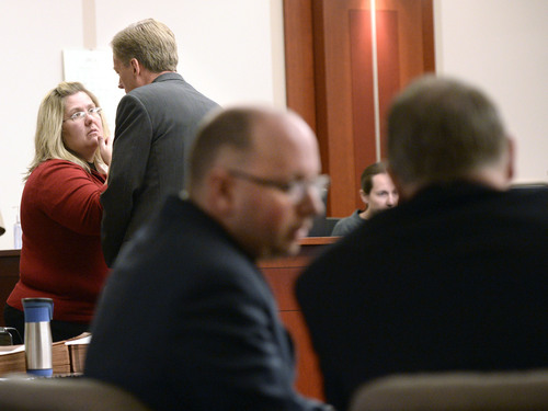 Al Hartmann  |  The Salt Lake Tribune Defense lawyers Denise Porter and Michael Peterson confer, left, as prosecuters Matt Janzen and Robert Parrish huddle during Esar Met's murder trial in Salt Lake City Wednesday January 15, 2014. The defense asked Judge Judith Atherton to declare a mistrial when new possible blood evidence was introduced. Esar Met is accused of killing 7-year-old Hser Ner Moo, who disappeared on March 31, 2008.