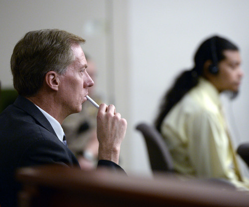 Al Hartmann  |  The Salt Lake Tribune Defense lawyer Michael Peterson listens to forensic testimony in Esar Met's murder trial in Salt Lake City  Tuesday January 15, 2014. Esar Met is accused of killing 7-year-old Hser Ner Moo, who disappeared on March 31, 2008.