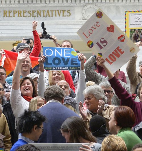 Rick Egan  | The Salt Lake Tribune   Crowds of couples who were married over the 17 days celebrate on the steps of the Capitol, Friday, January 10, 2014, as supporters of gay marriage rallied in the Capitol Rotunda to discuss the same-sex marriage lawsuit events and deliver petitions with 41,000 signatures to Utah Gov. Herbert, urging him to not appeal Judge Robert J. Shelby's ruling.